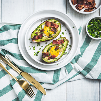Avocado with egg and bacon